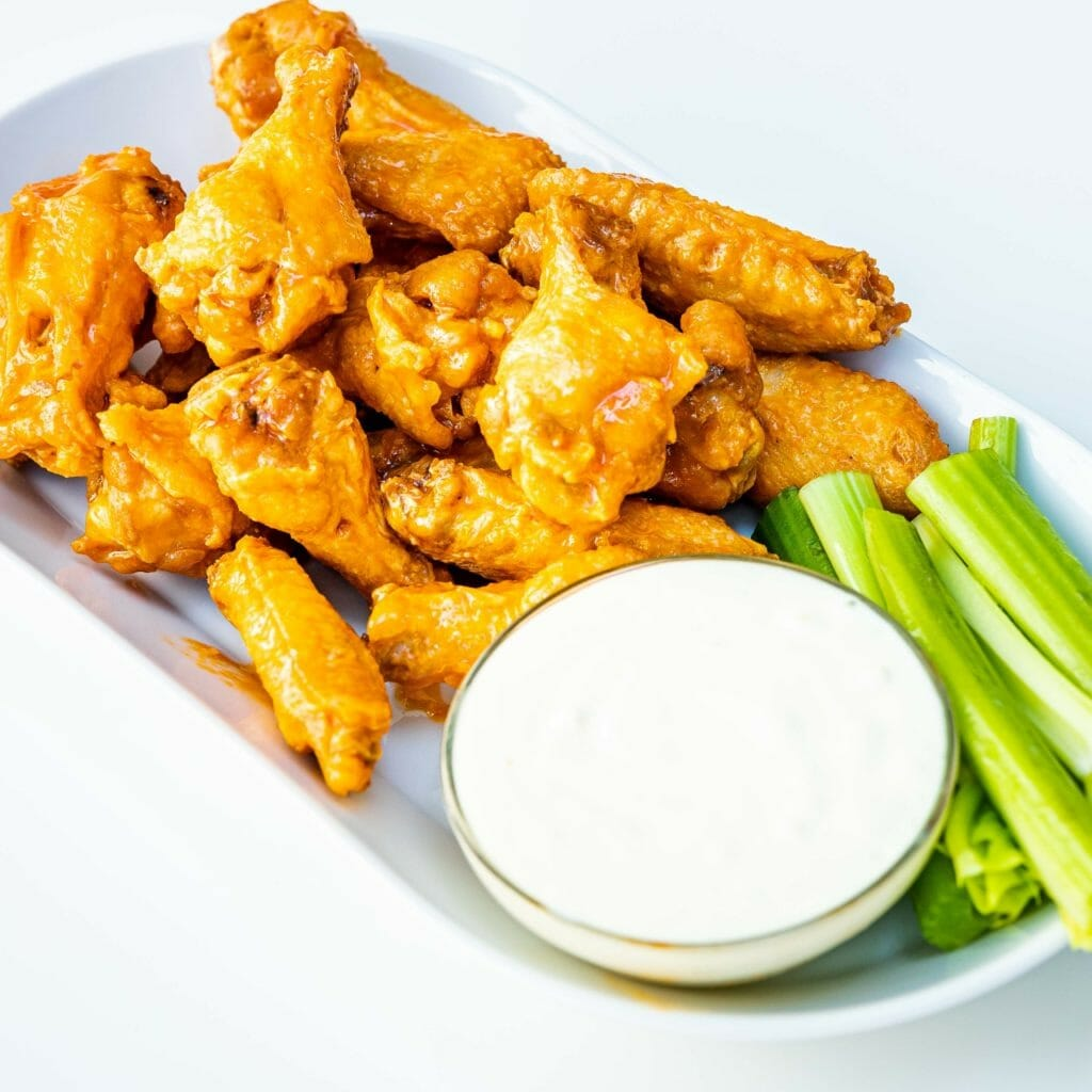 Wings and celery sticks image